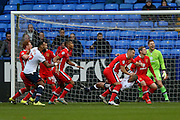 MK Dons defender Antony Kay  wrestles with Bolton Wanderers midfielder Darren Pratley  at a corner during the Sky Bet Championship match between Bolton Wanderers and Milton Keynes Dons at the Macron Stadium, Bolton, England on 23 January 2016. Photo by Simon Davies.