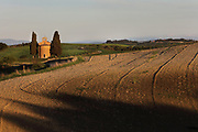 The Cappella della Madonna di Vitaleta, or Chapel of Our Lady of Vitaleta, a tiny chapel originally built in the late Renaissance and consecrated in 1590, and redesigned in 1884 by Giuseppe Partini, 1842-95, in Vitaleta, Tuscany, Italy. The building is on the road between Pienza and San Quirico d'Orcia and has stone facades and a small rose window. Picture by Manuel Cohen