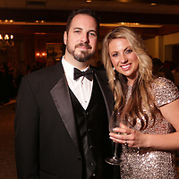 Josh Kneeland, left, and Karen Kneeland pose for a picture Saturday December 6, 2014 during the 9th Annual Wilmington Fur Ball at the Country Club of Landfall in Wilmington, N.C. (Jason A. Frizzelle)