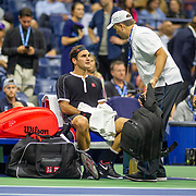 2019 US Open Tennis Tournament- Day Nine.  Roger Federer of Switzerland requests treatment after the fourth set against Grigor Dimitrov of Bulgaria in the Men's Singles Quarter-Finals match on Arthur Ashe Stadium during the 2019 US Open Tennis Tournament at the USTA Billie Jean King National Tennis Center on September 3rd, 2019 in Flushing, Queens, New York City.  (Photo by Tim Clayton/Corbis via Getty Images)