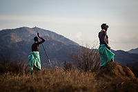 Samburu warriors guide a group of travelers on a walking safari through the mountains of the Matthews Range, Kenya.