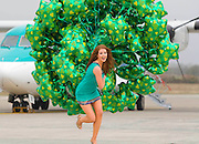 "15/3/2012. News. Free To Use Image. Waterford Airport St. Patrick Day.<br /> Up Up and Away, model Lisa Kavanagh on her way to 'Take Off' at 'Waterford Airport-Waterford Airport has extra reasons to celebrate the Shamrock today as flights to and from the Airport go live for the first time ever on aerlingus.com  – photograph Patrick Browne<br />  <br /> Tourism boost for southeast with Aer Lingus Regional services to Waterford Airport<br />  <br /> Waterford Airport has welcomed the announcement that Aer Lingus Regional flights are to operate to and from Waterford as a major boost to tourism in the southeast region.<br />  <br /> From March 25, the routes connecting London Luton; London Southend and Manchester to Waterford will carry the famous Aer Lingus shamrock and passengers are now able to book through www.aerlingus.com.  This opens out the routes to a far larger pool of potential passengers in Ireland and, particularly, in the UK.  The Aer Lingus Regional routes will be operated under a franchise agreement with Aer Arann.<br />  <br /> Welcoming the development ahead of the peak 2012 summer season, Graham Doyle, CEO, Waterford Airport, said: ""Aer Lingus is a powerful international airline brand which is very valuable in selling flights to and from the southeast. You get a sense of their scale with almost 600,000 passengers carried in February alone.<br />  <br /> ""There is huge traffic through www.aerlingus.com and it is great that, for instance, someone in the UK as they research flight options to Ireland will now be able to see the various routes available to bring them to Waterford and Ireland's southeast from Luton, Southend or Manchester. Tourism is hugely important to the southeast and the industry now has the opportunity to promote easy access directly to the region from these huge catchment areas in Britain.<br />  <br /> ""The Aer Lingus website is their primary distribution channel and is supported by all of the airline's marketing activity as well as in their partnership work with tourism agencies. Th"