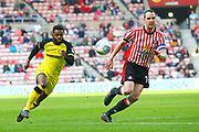 Burton Albion's Darren Bent and Sunderland's John O?Shea during the EFL Sky Bet Championship match between Sunderland and Burton Albion at the Stadium Of Light, Sunderland, England on 21 April 2018. Picture by John Potts.