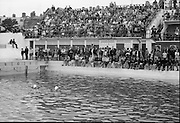 Gallagher High Diving Gala.<br /> 1966.<br /> 01.07.1966.<br /> 07.01.1966.<br /> 1st July 1966.<br /> The Gallagher Sponsored High Diving Gala was held today at The Blackrock Swimming Bath. Sandycove Swimming Club were the holders of the event. <br /> Image shows The Connolly sisters, Maureen and June performing a synchronized swimming routine before a packed house at the Blackrock Baths,Dublin.
