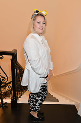 Singer ELLI INGRAM at the launch of the new Marina Rinaldi flagship store at 5 Albemarle Street, London on 3rd July 2014.