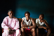 From left, Abdulai Koroma and his sons Amidu, 18 years old and Ibrahim, 22 years old at their home in Kenema, Kenema District, Sierra Leone on June 3, 2017. Abdulai's wife and the boys' mother Kadiatu died of malaria 2 weeks before. When Kadiatu fell ill, her condition wasn&rsquo;t serious so they tried to look after her at home. After three days though, her condition worsened so they decided to take her to hospital. Mariama was diagnosed with severe malaria at the hospital but she didn&rsquo;t survive.<br /> <br /> &ldquo;Her death is a still a shock to me and the children. We didn&rsquo;t expect her to die of this sickness. We were married for 25 years and she was very devoted to our family. She didn&rsquo;t mind making sacrifices just to make us happy. She was very helping in making sure we sell crops from our farm at very good prices,&rdquo; said Abdulai. <br /> <br /> &ldquo;My mother&rsquo;s death is affecting me a lot because she was the one providing most of my school needs. I am trying to be ok but it is not easy. I have even just been driven away from school because I owe school fees. I am not sure how I am going to get money to support myself and meet my school needs. I want to be lawyer after I complete school but I wonder if that will happen without my mother.&rdquo; said Amidu. <br /> <br /> &ldquo;We were hoping that she will recover from the sickness. We were really shocked when we went to see her in the morning and were told that she had died,&rdquo; said Ibrahim.