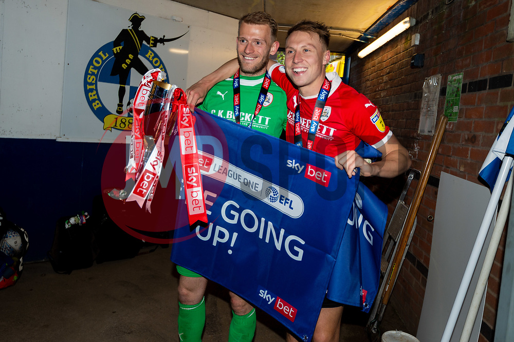 Adam Davies of Barnsley and Cauley Woodrow of Barnsley celebrates after the final whistle of the match after Barnsley secure automatic promotion to the Sky Bet  Championship   - Mandatory by-line: Ryan Hiscott/JMP - 04/05/2019 - FOOTBALL - Memorial Stadium - Bristol, England - Bristol Rovers v Barnsley - Sky Bet League One