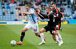 Huddersfield Town's Joel Lynch competes with Fulham's Ashley Richards - Photo mandatory by-line: Richard Martin-Roberts/JMP - Mobile: 07966 386802 - 21/03/2014 - SPORT - Football - Huddersfield - John Smith's Stadium - Huddersfield Town v Fulham - Sky Bet Championship