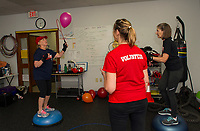 "Volunteer Kate Fox keeps time while Carol Sacknoff and Barbara Lewis work on agility and balance drills during their ""Rock Steady Boxing"" class at the Downtown Gym Thursday.  (Karen Bobotas/for the Laconia Daily Sun)"