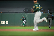 Oakland Athletics center fielder Rajai Davis (11) chases down a fly ball against the San Francisco Giants at AT&T Park in San Francisco, California, on March 30, 2017. (Stan Olszewski/Special to S.F. Examiner)