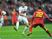 Montenegro's Filip Kasalica and Robert Lewandowski of Poland during the FIFA World Cup 2014 group H qualifying football match of Poland vs Montenegro on September 6, 2013 in Warsaw, <br />Photo by: Piotr Hawalej