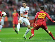 Montenegro's Filip Kasalica and Robert Lewandowski of Poland during the FIFA World Cup 2014 group H qualifying football match of Poland vs Montenegro on September 6, 2013 in Warsaw, <br />