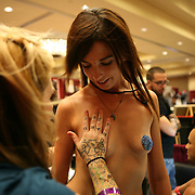 Body piercer Jenn Chaos gets ready to pierce Erica McGrane from Fort Lauderdale at the 18th Annual South Florida Tattoo Expo.<br /> Photography by Jose More