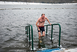 © Licensed to London News Pictures. 02/03/2018. London, UK. Members of the Serpentine Swimming Club brave -1°C water temperatures in the Serpentine in Hyde Park. The 'Beast from the East' and Storm Emma have brought extreme cold, ice and heavy snow to the UK. Photo credit: Rob Pinney/LNP