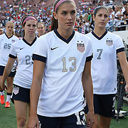 U.S. forward Alex Morgan (13) is seen on the sidelines prior to a women's soccer International friendly match between Brazil and the United States National Team, at the Florida Citrus Bowl  on Sunday, November 10, 2013 in Orlando, Florida. The U.S won the game by a score of 4-1.  (AP Photo/Alex Menendez)