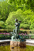"Conservatory Garden with the English Garden's Burnett Fountain depicting Dickon and Mary from the book ""The Secret Garden."" Central Park, New York City."