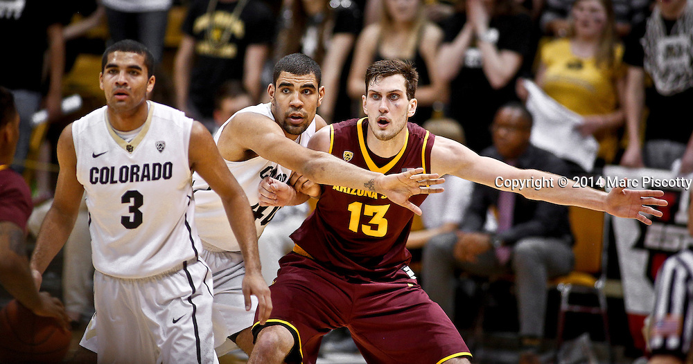 SHOT 2/19/14 11:34:05 PM - Arizona State's Jordan Bachynski #13 tries to post up in front of Colorado's Josh Scott #40 during their regular season Pac-12 basketball game at the Coors Events Center in Boulder, Co. Colorado won the game 61-52.<br /> (Photo by Marc Piscotty / &copy; 2014)