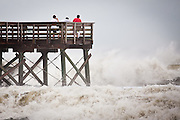 Onlookers watch the massive waves caused by passing Hurricane Irene on August 26, 2011 in Isle of Palms, South Carolina. The Hurricane is expected to only brush Charleston on the way to North Carolina.