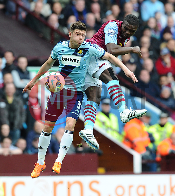 Aston Villa's Jores Okore battles for the high ball with West Ham United's Aaron Cresswell  - Photo mandatory by-line: Joe Meredith/JMP - Mobile: 07966 386802 - 09/05/2015 - SPORT - Football - Birmingham - Villa Park - Aston Villa v West Ham United - Barclays Premier League