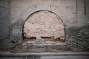 The doorway of a building in the ancient city of Pingyao is is blocked up with bricks.