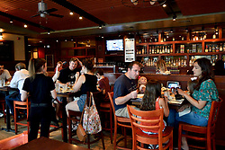 Families have lunch at the Iron Hill Brewery, in Phoenixville, PA, on August 21, 2018. (Bastiaan Slabbers for WHYY)