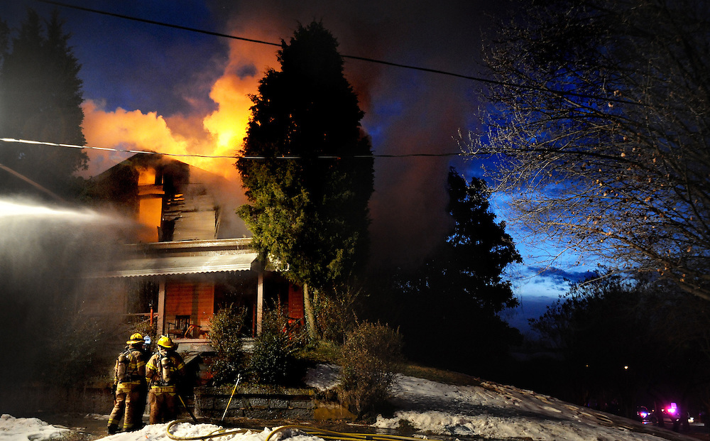 Lynchburg City Fire Fighters tend to a blaze on the corner of Taylor and Fifth Street in Lynchburg, Va.