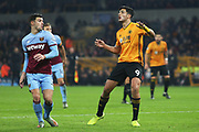Raul Jimenez and Aaron Cresswell in action during the Premier League match between Wolverhampton Wanderers and West Ham United at Molineux, Wolverhampton, England on 4 December 2019.