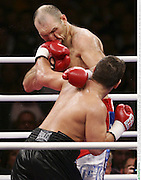 WBA Heavyweight Champion Nikolai Valuev who defends his world title against Britain's David Haye in Germany on Nov 7th 2009 is tagged by a left hook during his defeat to Ruslan Chagaev.
