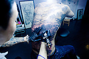 "ZHUZHOU, CHINA - APRIL 18: (CHINA OUT) <br /> <br /> Man Has whole painting Tattooed on to his back<br /> <br /> 24-year-old Yang Zhengwei gets a tattoo of ""Qingming Picture"", which is adapted from a famous Chinese painting on April 18, 2014 in Zhuzhou, Hunan Province of China. The 50-centimetre-long, 38-centimetre-wide tattoo on Yang's back was almost finished after five days of work by 38-year-old A Wei(nickname). The painting, attributed to Song Dynasty artist Zhang Zeduan, was originally a panoramic painting on a scroll depicting the daily life scenery of a river in the capital Bianjin. <br /> ©Exclusivepix"