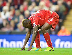 25.10.2014, Anfield, Liverpool, ENG, Premier League, FC Liverpool vs Hull City, 9. Runde, im Bild Liverpool's Mario Balotelli looks dejected after missing a chance against Hull City // 15054000 during the English Premier League 9th round match between Liverpool FC and Hull City at the Anfield in Liverpool, Great Britain on 2014/10/25. EXPA Pictures &copy; 2014, PhotoCredit: EXPA/ Propagandaphoto/ David Rawcliffe<br /> <br /> *****ATTENTION - OUT of ENG, GBR*****