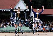 Scottish girls in tartan kilts dancing the sword dance at the Braemar Royal Highland Gathering, the Braemar Games in Scotland