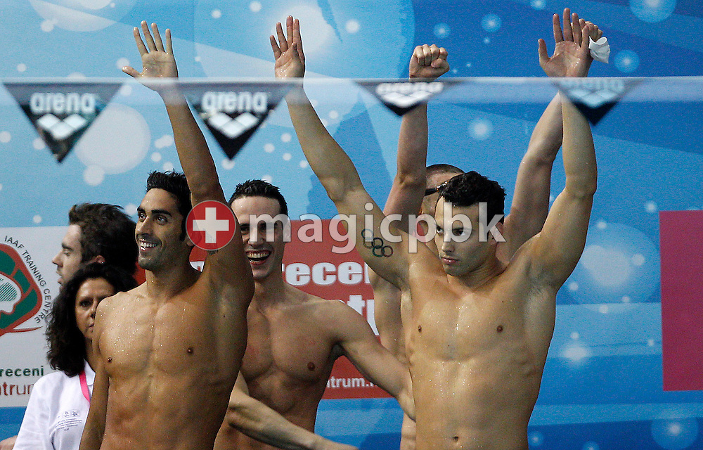 (L-R) Filippo MAGNINI, Fabio SCOZZOLI, Mirco DI TORA and Matteo RIVOLTA (hidden) of Italy celebrate after winning the men's 4x100m Medley Relay Final during the 31st LEN European Swimming Championships in Debrecen, Hungary, Sunday, May 27, 2012. (Photo by Patrick B. Kraemer / MAGICPBK)