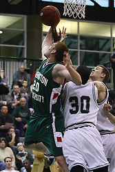 17 December 2011:  Dylan Richter wins the battle for possession  during an NCAA mens division 3 basketball game between the Washington University Bears and the Illinois Wesleyan Titans in Shirk Center, Bloomington IL