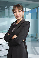 Business woman in office building smiling portrait