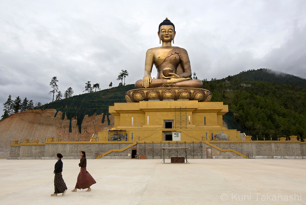 Visitors walk in front of The Sitting Buddha in Thimphu, Bhutan on September 1, 2013. The 169ft (51m) bronze statue, which will be accommodating 100,000 statues of eight-inch and 25,000 statues of 12-inch Buddha, is scheduled to be completed in 2014.<br /> (Photo by Kuni Takahashi)