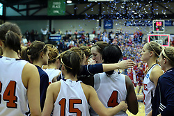 20 March 2010: Confetti flies in the background over the winning Bears as the Flying Dutch gather to console each other and get 2nd place in perspective. The Flying Dutch of Hope College fall to the Bears of Washington University 65-59 in the Championship Game of the Division 3 Women's NCAA Basketball Championship the at the Shirk Center at Illinois Wesleyan in Bloomington Illinois.