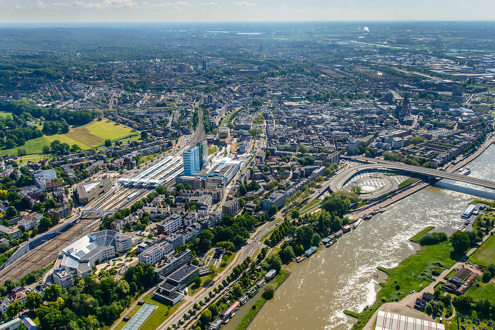 Nederland, Gelderland, Arnhem, 29-05-2019; zicht op de Nederrijn en de binnenstad, met het nieuwe NS-station en omgeving.<br /> View of the Lower Rhine and the city center, withthe new NS station and surroundings.<br /> <br /> luchtfoto (toeslag op standard tarieven);<br /> aerial photo (additional fee required);<br /> copyright foto/photo Siebe Swart