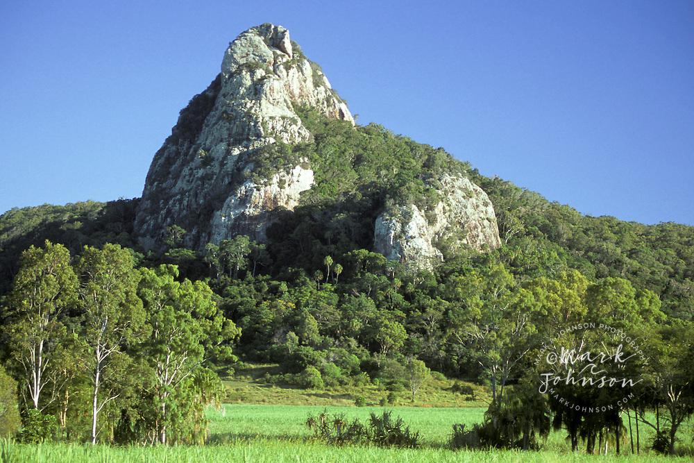 Australia, Queensland, sugar cane growing near rock formation near Cape Hillsborough National Park.