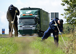 © Licensed to London News Pictures. 15/08/2013. Thirsk, Police searching for Rania Alayed along the A19 in the Thirsk area between Boroughbridge and Northallerton. Police are appealing for sightings of a white campervan in the area between 0300 and 0500 on saturday 8th june this year. Photo credit : Nigel Roddis/LNP.