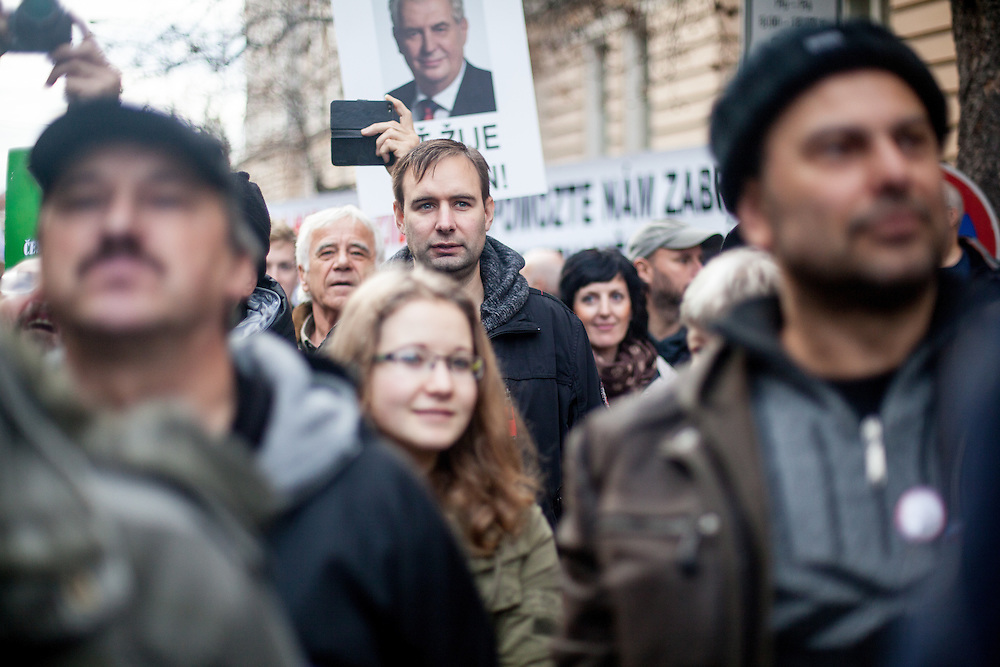 Protestors during an anti-Islam rally in Prague. Czech Republic celebrates that day the 26th anniversary of the Velvet Revolution which took place in 1989. In the back an image of Czech President Milos Zeman.
