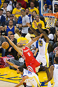 Golden State Warriors guard Stephen Curry (30) strips Houston Rockets guard Eric Gordon (10) of the ball during a lay up attempt during Game 6 of the Western Conference Finals at Oracle Arena in Oakland, Calif., on May 26, 2018. (Stan Olszewski/Special to S.F. Examiner)