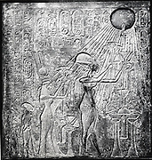 Akhenaten (Amenhotep IV) heretic pharaoh, reigned from c150 BC, here with Nefertiti and their two daughters offering gifts to the Sun. Relief originally in Temple of Sun, Thebes. Linen garments