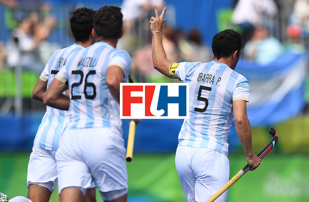 Argentina's Pedro Ibarra (R) celebrates scoring a goal during the men's field hockey Argentina vs Germany match of the Rio 2016 Olympics Games at the Olympic Hockey Centre in Rio de Janeiro on August, 11 2016. / AFP / MANAN VATSYAYANA        (Photo credit should read MANAN VATSYAYANA/AFP/Getty Images)