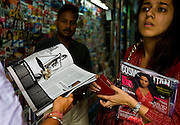 Customers browse and purchase Indian and Indian versions of international magazines at a newsstand in Khan market in New Delhi on 18 September 2008. Photo : Suzanne Lee for The National.