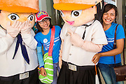 09 DECEMBER 2012 - BANGKOK, THAILAND:  Thai college students pose for photos with anti-corruption mascots during an anti-corruption rally at the Bangkok Art and Culture Centre (BACC). About 1,500 Thai university students from 90 universities across Thailand attended the rally. The latest Corruption Perceptions Index survey by Transparency International listed Thailand at number 88 out of 176 countries surveyed. The level of corruption in Thailand is perceived to be on the same par as Malawi, Swaziland and Zambia. Thailand's ranking slipped from 80 last year. A series of surveys show that Thais increasingly view corruption as acceptable. A recent ABAC (Assumption Business Administration College, the forerunner to Assumption University, one of the most respected private universities in Thailand) poll reported that a majority (63 per cent) of Thai people hold the view that corruption in government is acceptable as long as they also benefit from it. A majority of young people under 20 now hold the same attitude. International Anti-Corruption Day has been observed annually, on the 9th December, since the passage of the United Nations Convention Against Corruption on 31 October 2003.       PHOTO BY JACK KURTZ