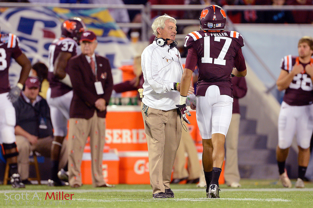 Virginia Tech Hokies head coach Frank Beamer talks with Virginia Tech Hokies cornerback Kyle Fuller (17) during the first half of the the Russell Athletic Bowl against Rutgers Scarlet Knights on Dec 28, 2012 in Orlando, Florida. Virginia Tech won the game 13-10 in overtime....©2012 Scott A. Miller..