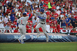October 7, 2017 - Washington, DC, USA - The Chicago Cubs' Willson Contreras celebrates his home run with third base coach Gary Jones (1) in the second inning against the Washington Nationals in Game 2 of the National League Division Series at Nationals Park in Washington, D.C., on Saturday, Oct. 7, 2017. (Credit Image: © Brian Cassella/TNS via ZUMA Wire)