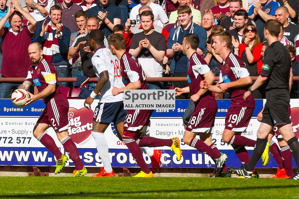 Hearts v Ross County Scottish Premiership 19 April 2014; Heart's Jamie Hamill teases Ross County's Yann Songo'o with the ball before barging Ross County manager Derek Adams and then being sent off;