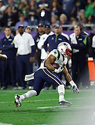 New England Patriots running back Shane Vereen (34) runs with the ball as he catches a pass for a 9 yard gain and a first down at the Seattle Seahawks 27 yard line due to an unnecessary roughness penalty against the Seahawks during the NFL Super Bowl XLIX football game against the Seattle Seahawks on Sunday, Feb. 1, 2015 in Glendale, Ariz. The Patriots won the game 28-24. ©Paul Anthony Spinelli