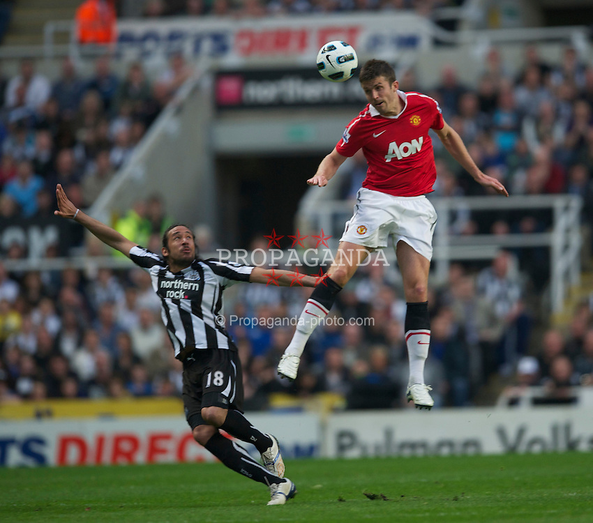 NEWCASTLE, ENGLAND - Tuesday, April 19, 2011: Manchester United's Michael Carrick and Newcastle United's Jonas Gutierrez during the Premiership match at St James' Park. (Photo by David Rawcliffe/Propaganda)